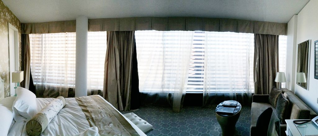 The panoramic view of the whole room in the morning. The room makes a quarter of a circle.