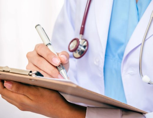 Image of health record, pen and stethoscope
