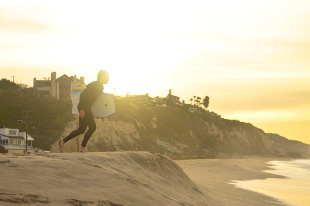 Image of man running on the beach