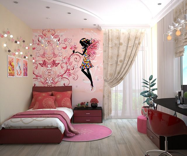 A generic girl's room with pink furniture, accessories, and a fairy painted on a wall.