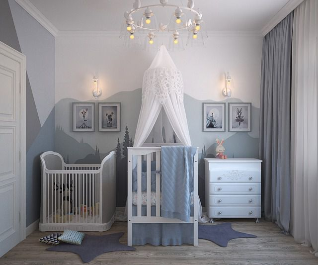 A white and grey room with a small bed and furniture for toddlers, as an example of how to redecorate your kid's room.