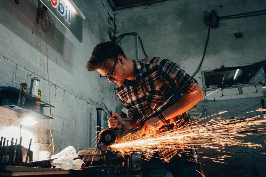 A man welding iron signifying that there are some things that you can DIY.