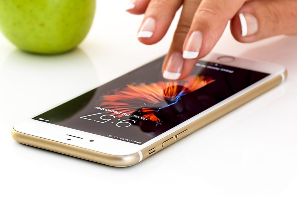 woman finger on mobile iphone