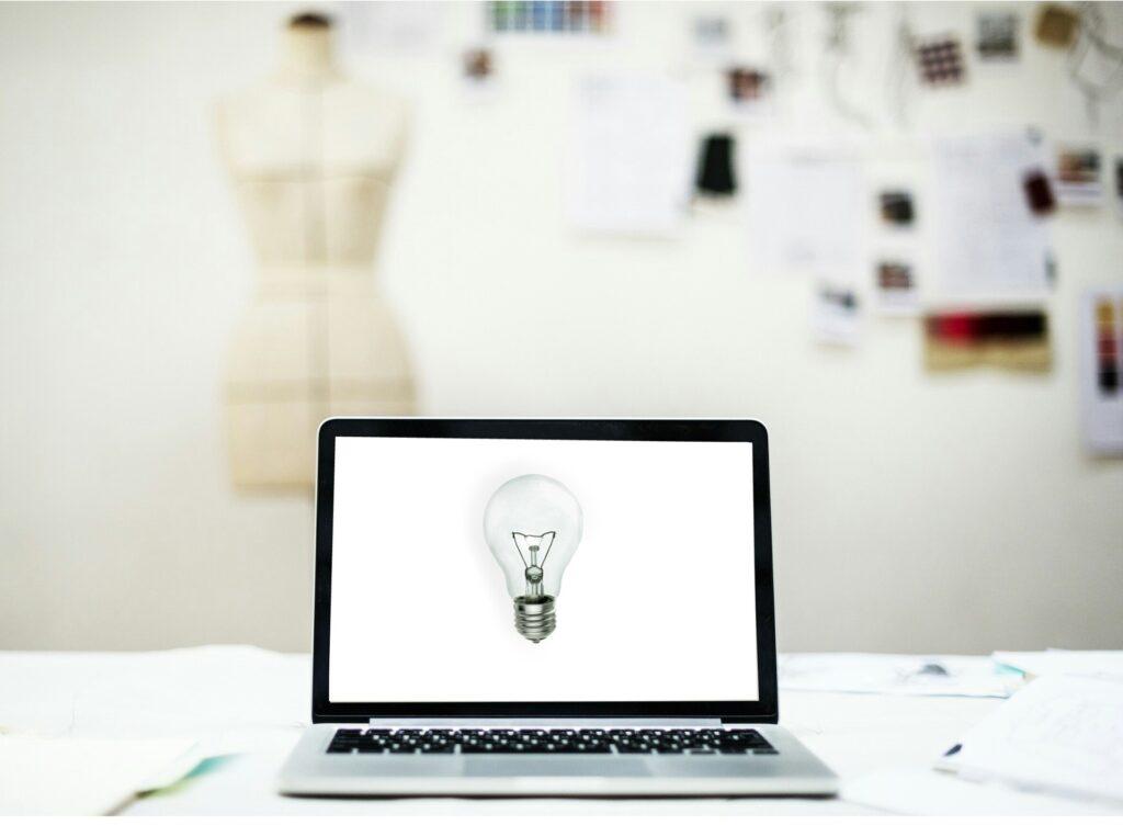 laptop with a bulb idea