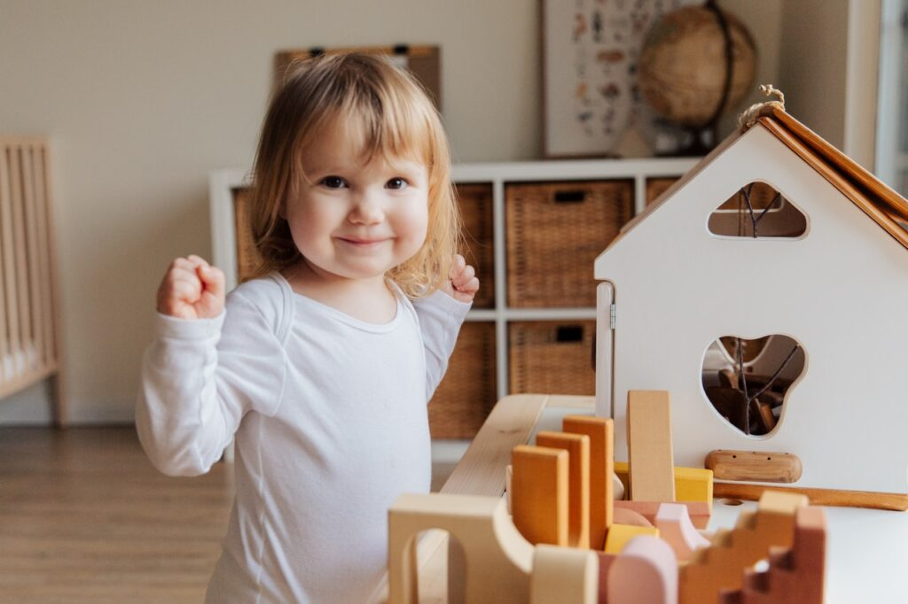 A baby girl playing with toys.