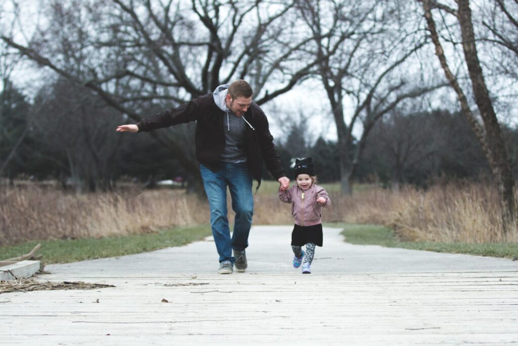 man and girl running