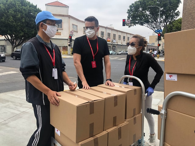 a moving team wearing masks during the pandemic