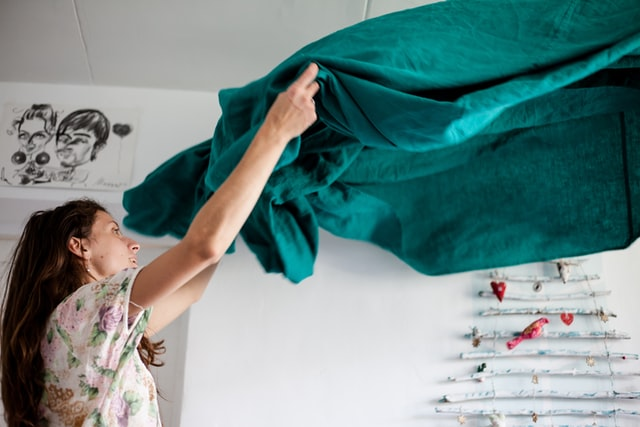 a woman making a bed
