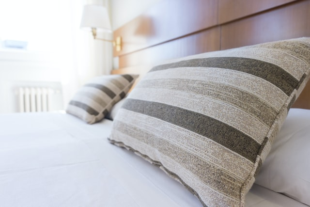 a bed in a clean home shows that cleaning and organizing can be therapeutic.