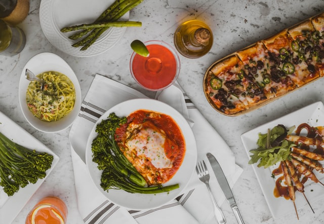 Italian dishes and ingredients on a table, showing that you can taste the flavors of the world without leaving Queens.