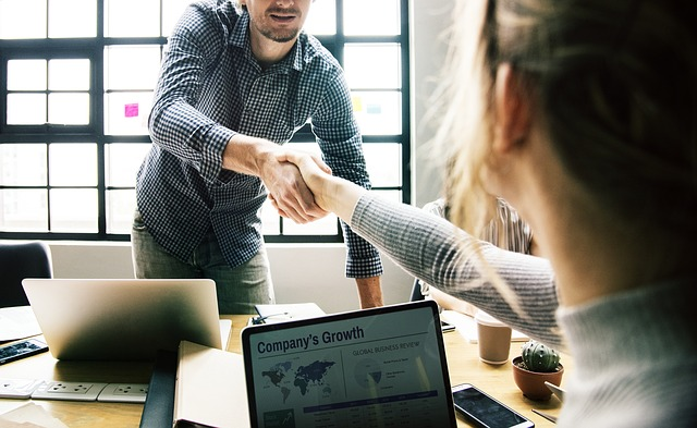 Two people shaking hands on a business interviews
