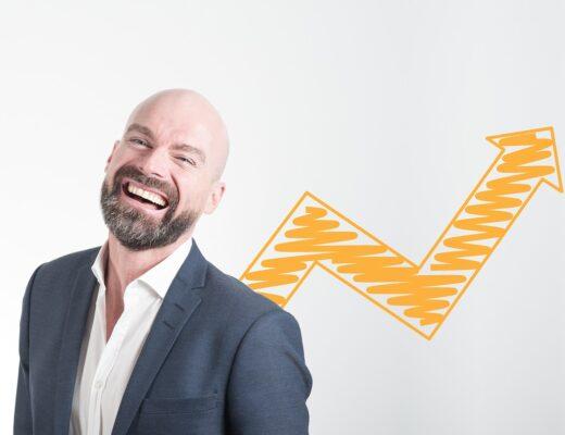 An entrepreneur smiling.