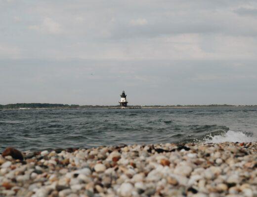 pebble beach with a lighthouse