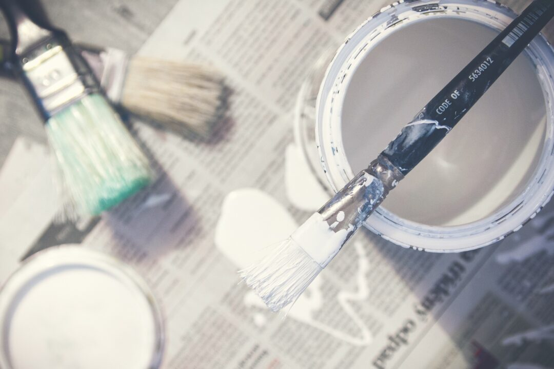 Paintbrushes and paint can.