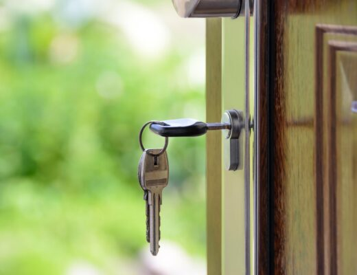 A black-handled key on a keyhole.