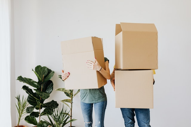A couple holding boxes